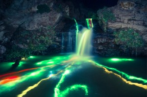 Glowsticks leaving colorful trails in waterfall (1)