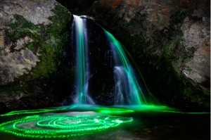 Glowsticks leaving colorful trails in waterfall (2)