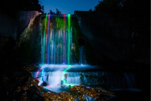 Glowsticks leaving colorful trails in waterfall (3)