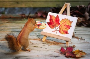 Squirrel painting picture of leaves