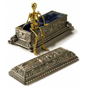 Miniature gold skeleton with silver gilt coffin