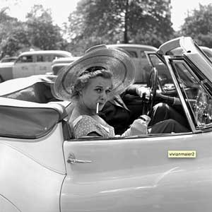 Photograph of stylish woman in car