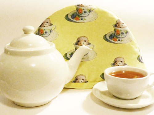Teapot, tea cozy and teacup