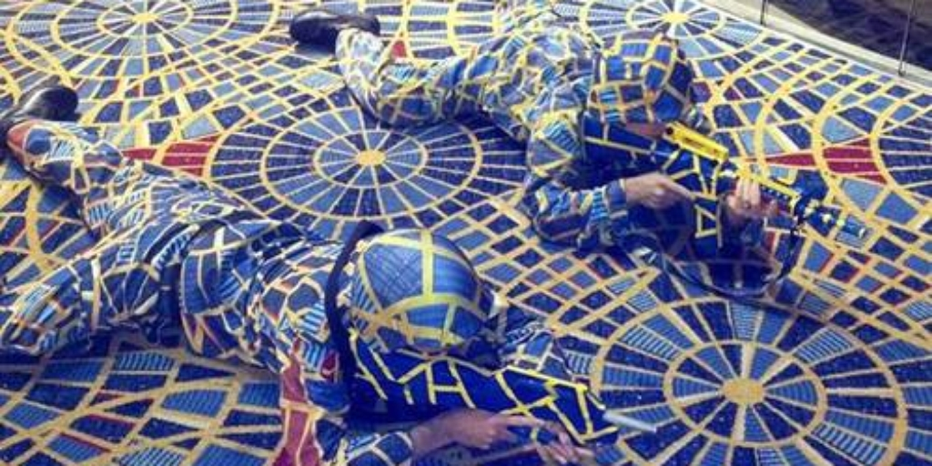 Cosplayers dressed in fabric that matches carpet