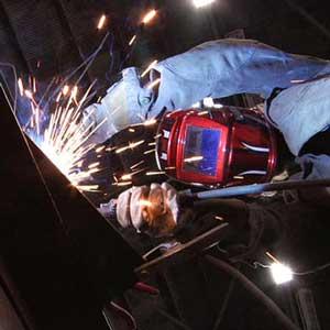 Karen Cusolito welding