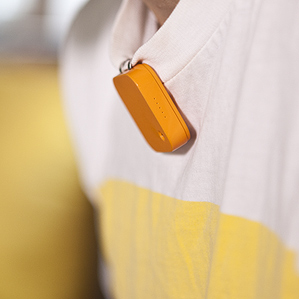 Miniature camera clipped onto shirt