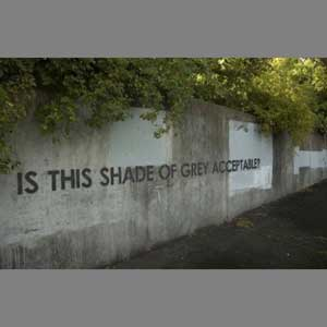 "Graffiti on wall; ""Is this shade of grey acceptable?"""