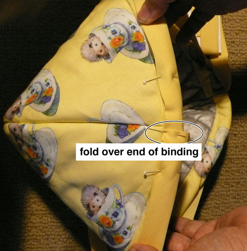 Fold over the end of the binding