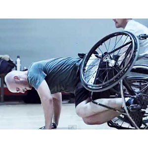 Man in wheelchair (from ad)