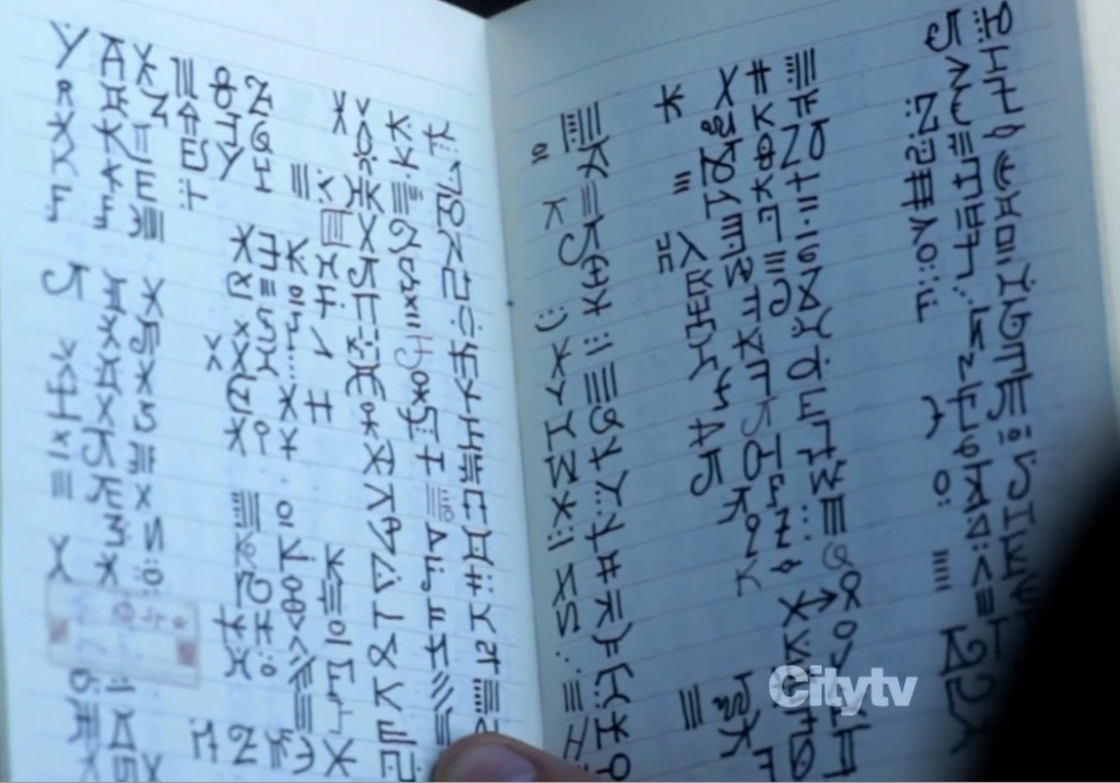 """Notebook with hand drawn """"Observer"""" text"""