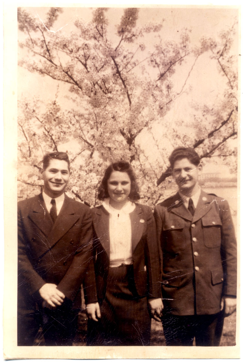 1940s? Wartime, anyway. Daddy in natty double-breasted suit, Manny's wife Helen in natty pinstriped skirt suit, Manny in uniform